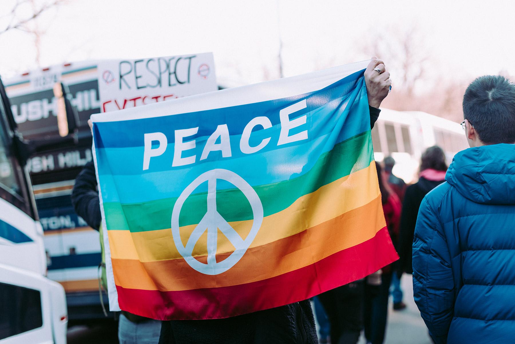 Rainbow flag with Peace symbol