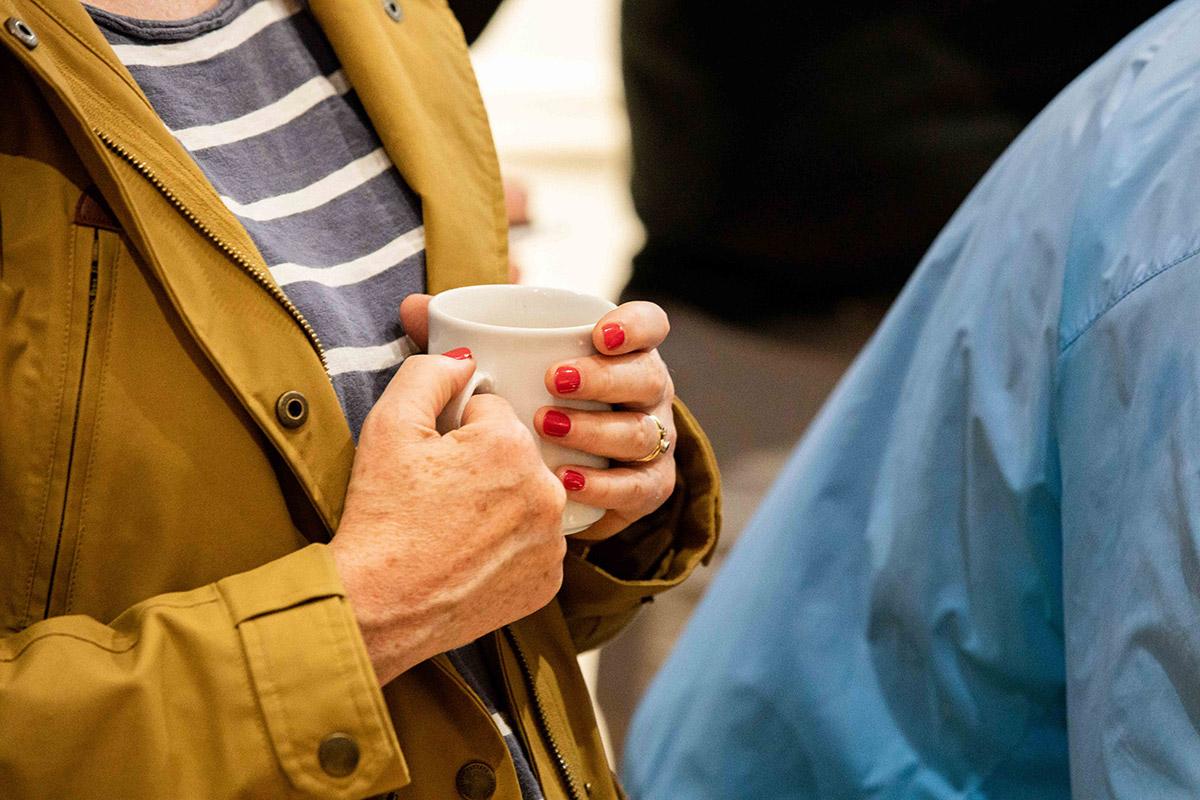 hands holding a mug
